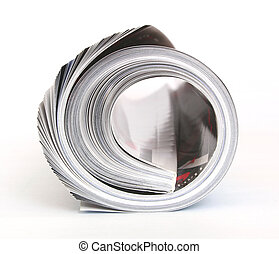 rolled magazine - close-up of a rolled magazine