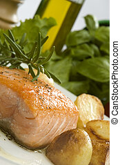 salmon - baked salmon steak with potato and rosemary