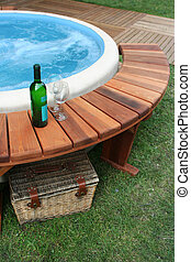 spa outside - wine bottle for evening bath