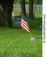 military veteran grave marker - American flag in a graveyard