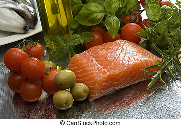 salmon - raw salmon steak with vegetables and olive oil in...