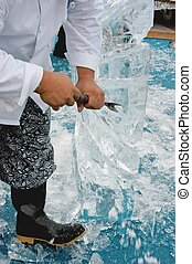 carving ice scuplture - man carving ice sculpture