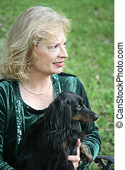 Dog & Owner in Profile - A portrait of a mature woman and...