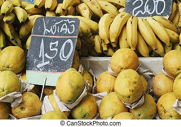 Bananas and papaya in a street market - Bananas and papaya...