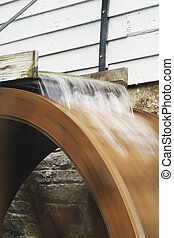 Water flowing over mill wheel