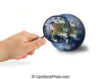 exploring our world - hand with magnifying glass over the...