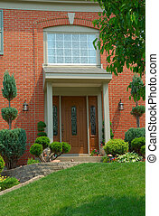Residential 2-story brick home entry