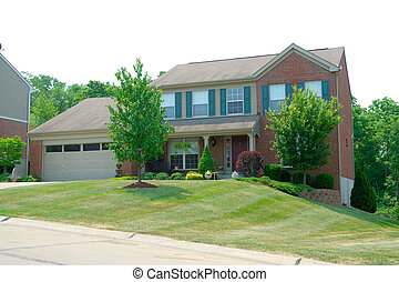 Residential 2-story brick home in an upscale suburban...