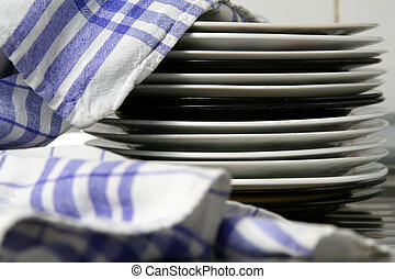 Dish washing - Dishes wiped with white blue checked...