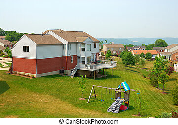 Neighborhood Back Yards - Residential two story brick homes...
