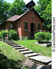 School House - A photo of a one room brick school house.