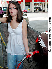 Pain at the Pump - Girl unhappy about high gas prices.