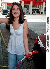 Smiling Girl Pumping Gas