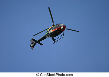 Blue Helecopter - Helicopter coming in to land at a open day