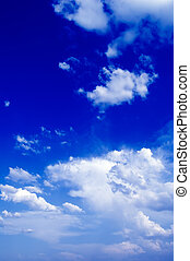 The clouds. - The blue sky and white clouds.
