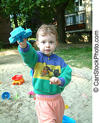 Child in the sand pit