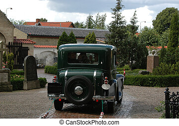 Old wedding car - Old car is driving the wedding couple...