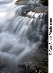 Cascading waterfalls. - Cascading waterfalls splash onto the...