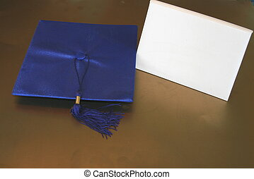 Graduation Cap and Diplom - Mortarboard and blank diploma.