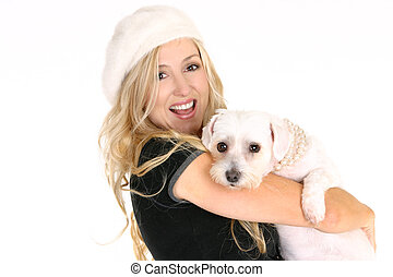 Smiling female holding a dog in her arms