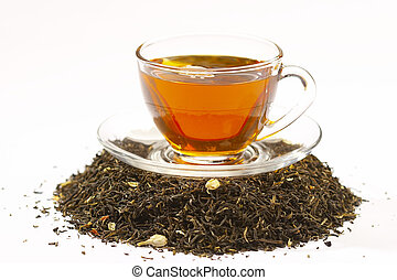 tea - Cup of green tea and tea leaves with dry jasmin