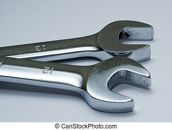 Two open ended spanners or wrenches isolated on a white...