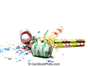 Party Horn Blowers - Party blowers and colorful confetti on...
