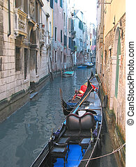 Gondola on a small water canal, Venice, Italia - Gondola on...