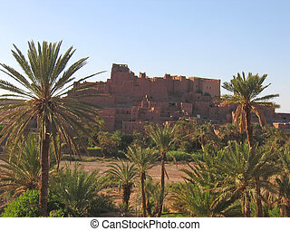 Moroccan ksar fortress with palm trees, Ouarzazate, Morocco...