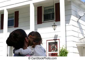 Mother and daughter are looking at their newly bought house