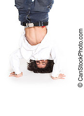 teen doing gim - teen up side down over white background