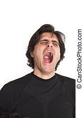 man yawning - portrait of man yawning over white background