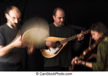 band playing celtic music over black background - blur...