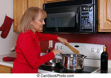 Dinner - A woman cooking pasta for dinner