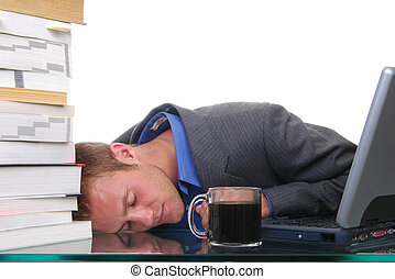 Passed Out - An overworked man passed out at his desk