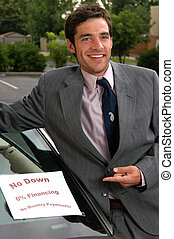 Used Car Salesman - A car salesman pointing at a car