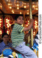 Carnival - An handsome indian kid having fun at a local...