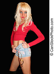 Woman in red - woman with manacles in red tanktop on black...