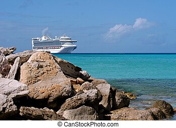 big cruise ship - large cruise ship docked near shore with...