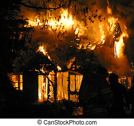 house fire - Fire consumes a house in...