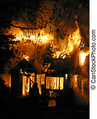 house fire - Firefighters try to contain a blazing house...