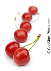 cherry - some red fresh cherries against white background