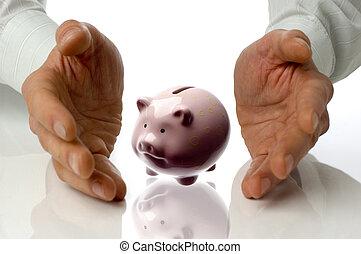 piggybank - business men holding piggybank between hands on...