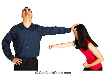 Businessman fighting with businesswoman on white background...