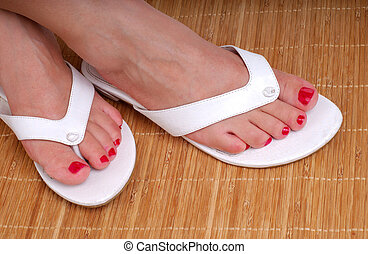 Feet At The Spa - Womans Feet With Red Painted Toe Nails...