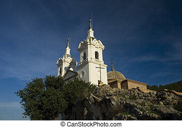 La Fuensanta sanctuary against a blue sky in Murcia, Spain.