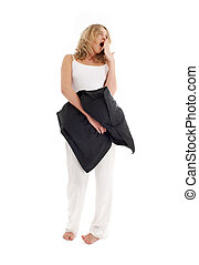 sleepy blond with black pillow over white