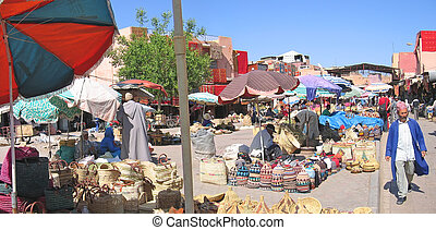 Souks near Jemaa el Fna place with a moroccan man walking,...