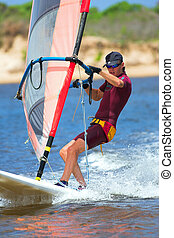 Windsurfer 15 - Fast moving windsurfer on the water at...