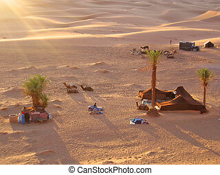 Sunset on the tent camp with camels, Erg Chebbi, Merzouga,...